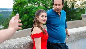 HUNT4K. Prague girl in beautiful red garments takes it off